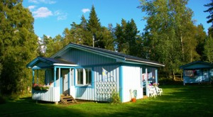 Our blue cottage in Sweden about 45m from the lake