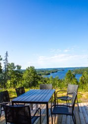Secluded cottage in Sweden with views over lake Ören from the terrace.